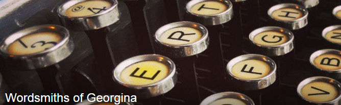 Keys of a typewriter with the words Wordsmiths of Georgina