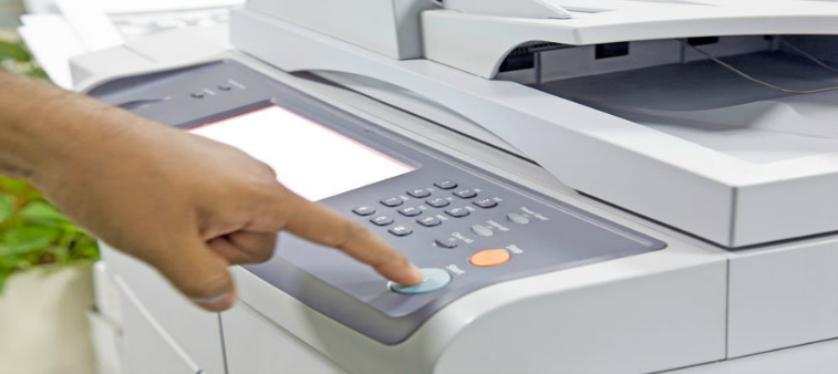 A person using a photocopier.